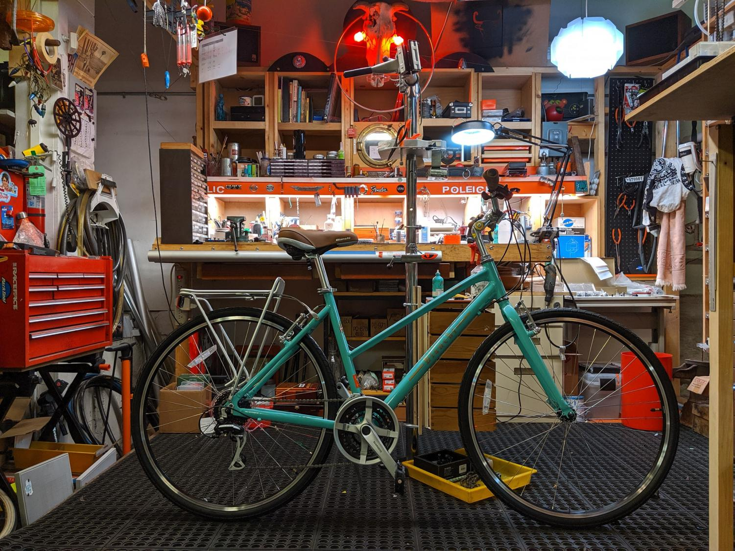 A Bianchi Turismo model sits in Bucephalus Bikes. Run by Alejandro Añón and his wife, Cecelia Wallin, the Lake St. Shop emphasizes car-free living.